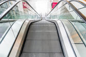 Empty escalator perspective from up to down — Stock Photo