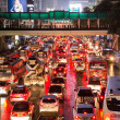 Stock Photo: Bad traffic on rainy night at Central World, Bangkok