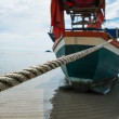 Stock Photo: Boat rope to anchor on beach