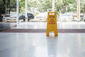 Wet floor sign on the floor — Stock Photo