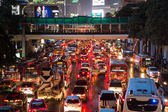 Bad traffic on rainy night at Central World, Bangkok — Stock Photo