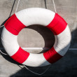 Hanging old life saving ring — Stock Photo
