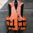 Hanging old life saving vest — Stock Photo