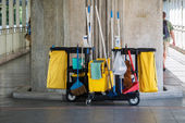 Two floor cleanup container on a walk way — Stock Photo