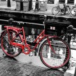 Red bicycle in Amsterdam — Stock Photo #29690263