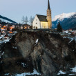 scuol church in winter time evening — Stock Photo