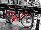 Red bicycle in Amsterdam — Stock Photo