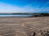 Dark sand beach — Stock Photo
