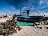 Devasted ship wreck on the beach — Stockfoto