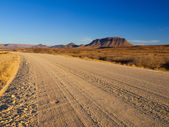 Gravel road and table mountain — Foto Stock