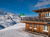Mountain hut with terrace in winter time — Stock Photo