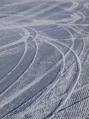 Downhill ski tracks on ski slope — Stock Photo