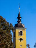 Yellow tower of village church — Stock Photo