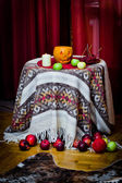 Halloween pumpkin, apples, berries, candle — Stock Photo