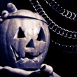 Stock Photo: Halloween pumpkin in girl's hands and chains