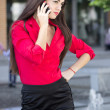 Businesswoman talking on the phone near the office building — Stock Photo