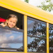 Little girl looking out of a school bus window — Stock Photo