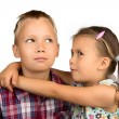 Little Girl Hugs her Older Brother — Stock Photo