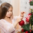 Girl Decorating Christmas Tree — Stock Photo #29545021