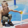 Stock Photo: Young Boy at Splash Zone