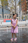 Young Girl at a Splash Fountain — Stock Photo