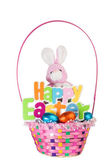 Toy Bunny and Colorful Basket full of Chocolate Easter Eggs — Stok fotoğraf