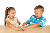Kids and a cupcake — Stock Photo