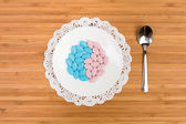 Colorful Pills on a saucer — Stock Photo