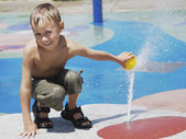 Young Boy at the Splash Zone — Stock Photo