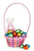 A Bunny and a Basket with Chocolate Easter Eggs — 图库照片