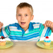 Boy And Two Cupcakes — Stock Photo