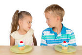 Two Kids and Two Cupcakes — Stock Photo