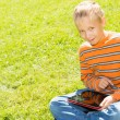 Boy with a Tablet Computer — Stock Photo