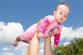 Little Baby Girl Against Cloudy Sky — Stock Photo