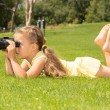 Stock Photo: Girl Lokking in Binoculars