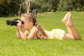 Girl Lokking in Binoculars — Stock Photo