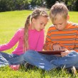 A Girl and A Boy With Tablet Computer — Stock Photo