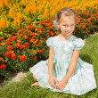 Stock Photo: Girl Near Flowerbed