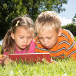 Boy and Girl and Tablet Computer — Stock Photo