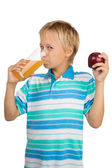 Boy Holds a Glass with an Apple Juice with One Hand and Apple i — Stock Photo