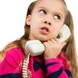 Stock Photo: Curious girl on Phone