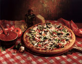 Pizza with toppings — Stock Photo