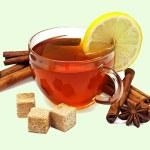 Tea with lemon and cinnamon on a light background — Stock Photo