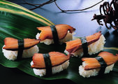 Sushi on a green leaf — Stock Photo