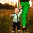 Adorable baby walking around with mother — Stock Photo