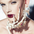 Surrealistic fashion portrait of a woman wearing jewellery — Stock Photo