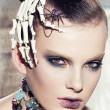 Stock Photo: Surrealistic fashion portrait of womwearing jewellery