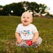 Baby with apple outdoors — Stock Photo
