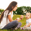 Baby eating outdoors — Stock Photo