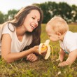 Baby eating outdoors — Stock Photo #39790823